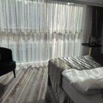 Deluxe Suite bed facing window